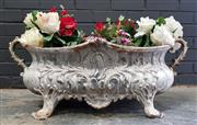 Sale 8993 - Lot 1041 - Rococo Style Cast Iron Planter, painted white, with central scroll & foliage, having two lobed handles (H: 27 x W: 76 x D: 32cm)