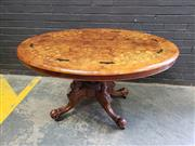 Sale 9048 - Lot 1095 - Good Victorian Burr Walnut & Marquetry Loo Table, the oval top with light floral inlays with dark contrasting panels, the edge cross...
