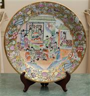 Sale 8630A - Lot 16 - A Cantonese charger in famille vert, with cartouche depicting a musical family gathering, on stand, D 40cm