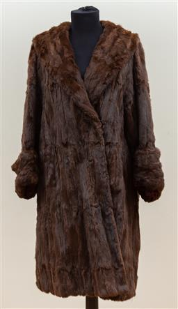 Sale 9165H - Lot 116 - A three quarter length chocolate long haired mink coat with large sleeves, lined with a burgundy leaf print silk, Size M