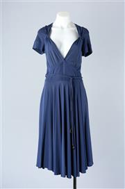 Sale 8782A - Lot 171 - A Gucci empire line midi-dress in a blue viscose knit with cap sleeves and fluted skirt, size M