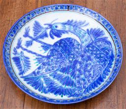 Sale 9190H - Lot 128 - A French terracotta wall charger painted in blue and white of a bird, Diameter 32cm