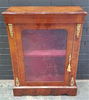 Sale 8993 - Lot 1001 - Victorian Walnut Pier Cabinet, with gilt brass mounts, the top with rosewood banded moulding, above an arched glass panel door (H:10...