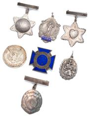 Sale 9046 - Lot 584 - SILVER MEDALS FOBS AND A COIN; a US Kennedy silver half dollar, 1964 Denver mint, a blue enamelled Maltese cross Trained Nurses Asso...