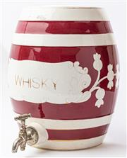 Sale 9083N - Lot 86 - A ceramic whisky barrel with chrome tap in burgundy and cream with gilt lettering. Height 33cm