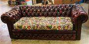 Sale 8516A - Lot 36 - An early maroon Chesterfield with contemporary Marvel comic cushions, age worn, slight rip on top. 200cm long x 65cm high x 90cm deep