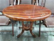 Sale 8728 - Lot 1016 - Small Victorian Walnut Loo Table, the oval striped pattern top above a birdcage base & outswept legs