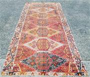 Sale 9014 - Lot 1013A - Turkish Malatya Wool Kilim, assembled from two strips, forming multi-coloured hooked guls on a red ground, with zig-zag border (some...