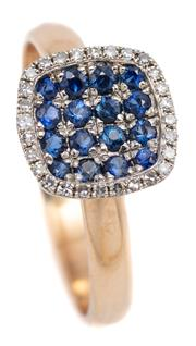 Sale 9083 - Lot 569 - AN 18CT GOLD SAPPHIRE AND DIAMOND RING; featuring a 9mm cushion shape concave top chequerboard set with 16 dark blue sapphires to a...