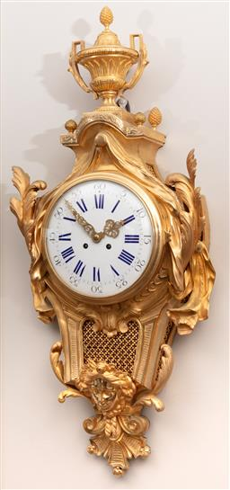 Sale 9130H - Lot 8 - An impressive Ormolu Cartel clock with trophy surmount and mask to base. Key, Height 92cm,