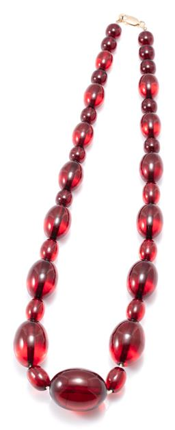 Sale 9156J - Lot 360 - A CHERRY AMBER COLOUR BAKELITE NECKLACE; graduated strand of 11 off round to 25 x 34mm oval beads to a 9ct gold parrot clasp, length...