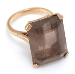 Sale 9169 - Lot 311 - A 9CT GOLD SMOKY QUARTZ COCKTAIL RING; claw set with an emerald cut quartz of approx. 21ct (chipped), width 21mm, size M, wt. 9.39g.