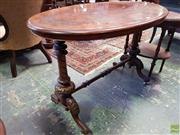 Sale 8598 - Lot 1072 - Victorian Inlaid Walnut Side Table, the oval top on turned supports & stretcher & raised on castors