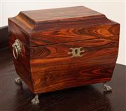 Sale 8868H - Lot 19 - A rosewood tea caddy with two internal compartments with brass inlay, lion mask ring handles and paw feet, Height 15cm, Width 20cm, ...