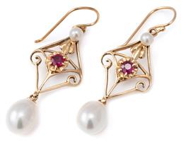 Sale 9124 - Lot 472 - A PAIR 9CT GOLD RUBY AND PEARL DROP EARRINGS; each a nouveau style setting centring a round cut ruby to a seed pearl surmount suspen...