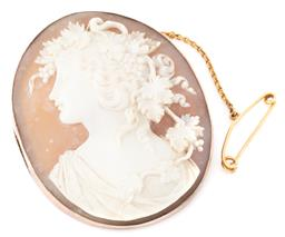 Sale 9149 - Lot 404 - AN ANTIQUE 9CT ROSE GOLD FRAMED CAMEO BROOCH; oval finely carved shell cameo depicting portrait of Bacchante in a plain frame with 1...