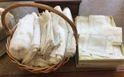 Sale 8310A - Lot 329 - A basket of cream linen table cloths and napkins