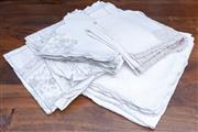 Sale 8568A - Lot 118 - A quantity of linen; includes two handworked large table cloths, each with 10 napkins with lace edging