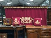 Sale 8882 - Lot 1011 - Red Wall Tapestry with Rail, with armorial of coronet over shield with three ships, supported by rampant lions & cushions