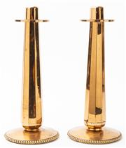 Sale 9083N - Lot 57 - A pair of faceted brass candlesticks 30cm