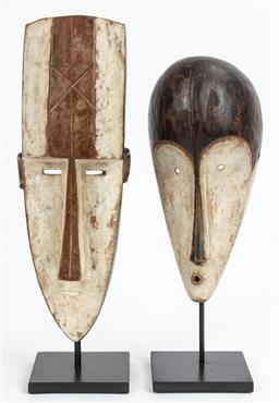 Sale 9130H - Lot 92 - Two carved timber Masks on metal stand. Height of tallest 57cm