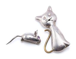 Sale 9194 - Lot 324 - STERLING SILVER CAT AND MOUSE BROOCHES; (Tom & Jerry), a seated cat, size 53 x 26mm with Mexican stamps, and a mouse with amethyst e...