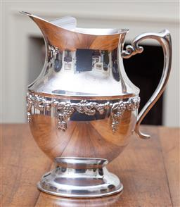 Sale 9190H - Lot 196 - A Crusader silverplate iced water jug C: 1940's, embossed with grape and vine decoration, in excellent condition Height 22cm
