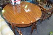 Sale 8317 - Lot 1065 - Georgian Style Mahogany Extending Dining Table with two later leaves, the D-ends on tapering gate-legs