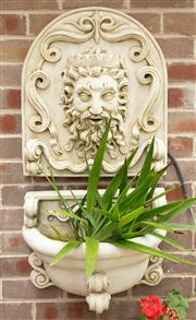 Sale 9070H - Lot 9 - A composite wall mounted water feature with Neptune mask in two pieces, Width 50cm, Overall Height 106cm