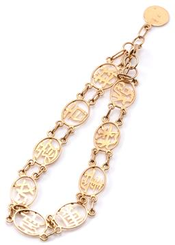 Sale 9132 - Lot 302 - A 14CT GOLD CHINESE BRACELET; 8.5mm oval links pierced with Chinese characters for Good Luck, Happiness, Fortune, etc to bolt ring c...