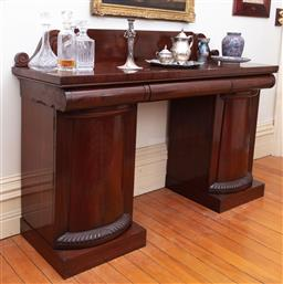 Sale 9190H - Lot 221 - Early 19th Century Mahogany Double Pedestal Sideboard, the low back with scrolled ends, three cushion frieze drawers & two pylon sha...