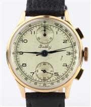 Sale 8655J - Lot 31 - A VINTAGE BREITLING 18CT GOLD CHRONOGRAPH WRISTWATCH; brushed dial, Arabic numerals, 2 registers, tachymeter track, 17 jewell Venus...