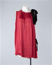 Sale 8782A - Lot 182 - A Prada baby doll dress in rouge silk with satin panelling to front and back with black neck tie, size 44