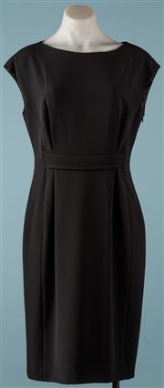 Sale 9090F - Lot 157 - A MOSCHINO BLACK DRESS; belt feature to front and back, side zip, size 44, triacetate and polyester fabric.