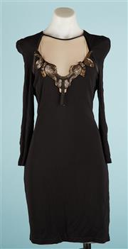 Sale 9090F - Lot 141 - A CUE LONGSLEEVE COCKTAIL DRESS; in black with accentuated shoulders, detachable applique and a mesh panel, (Size 14)