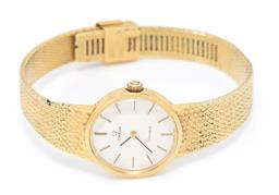 Sale 9177 - Lot 381 - A LADYS VINTAGE OMEGA WRISTWATCH; ref. 711.2022 gold plated stainless steel, round silvered dial, applied baton markers, 17 jewel ca...