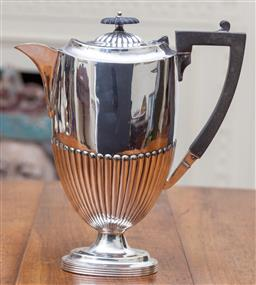 Sale 9190H - Lot 199 - An antique silverplate half fluted coffee pot, C: 1900 Height 24cm