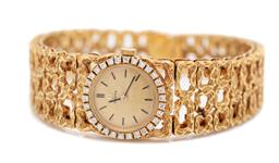 Sale 9099 - Lot 86 - A ladys 18ct yellow gold diamond set Omega manual wrist watch on an 18ct yellow gold cast design bracelet; the gold dial with black...