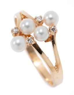 Sale 9177 - Lot 310 - A 9CT GOLD PEARL AND DIAMOND RING; long pillar claw set with 4 x 4mm round cultured pearls and 4 round brilliant cut diamonds, size...