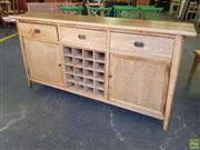 Sale 8637 - Lot 1008 - Oak Retro Style Sideboard with Three Drawers, Two Doors & Central Wine Rack (H: 91 W: 180 D: 44cm)