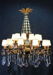 Sale 8444A - Lot 59 - An impressive and intricately designed brass and crystal 24 arm chandelier, in an antique French rococo style with pierced ornate br...