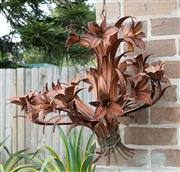 Sale 9070H - Lot 198 - A rusted iron chandelier depicting flowering lilies, Height approx 56cm