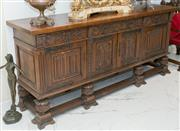 Sale 8338A - Lot 30 - A Renaissance style oak side board, with parquetry top, four drawers and four panel doors and cup and cover feet, H 100 x W 221 x D 56c