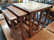 Sale 8839 - Lot 1036 - G-Plan Teak Nest of Three Tables - one tiled top