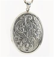 Sale 8866 - Lot 521 - A STERLING SILVER LOCKET ON CHAIN; oval locket with floral decoration on a cable link chain.