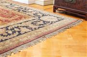 Sale 8630A - Lot 24 - A large Cadrys vintage Indian Jaipuri finely knotted carpet on red ground with gold acanthus motif and black border, 570 x 370