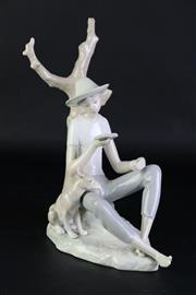 Sale 8890 - Lot 33 - A Large Nao Figure of A Boy Reading (H 31cm)
