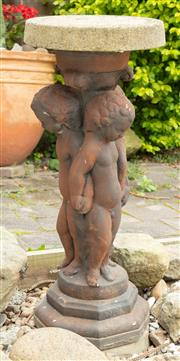 Sale 9070H - Lot 200 - A jardinere stand depicting three puttis holding hands, Height 70cm x Diameter 29cm