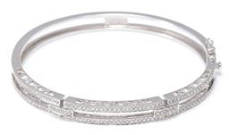 Sale 9164J - Lot 390 - A 18CT WHITE GOLD DIAMOND BANGLE; 2 row hinged bangle set with round brilliant cut diamonds between uniting bars further set with ro...