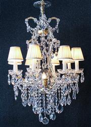 Sale 8444A - Lot 85 - A grand and exquisite fully restored Swarovski Strass crystal 8 arm chandelier with gold frame, with intricately beaded canopy, colu...